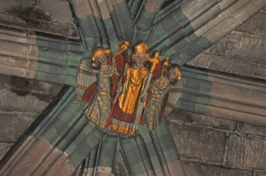 Painted roof boss in Winchester Cathedral with a partial restoration of the original paint on the rib vaulting (Note the intricate striped pattern)