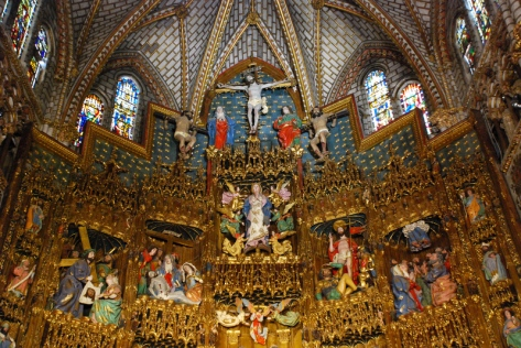 This painted altarpiece at Toledo Cathedral gives us a glimpse of what the exterior of a medieval cathedral may have looked like (without so much gold leaf)